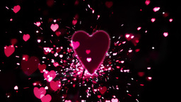 Pink heart confetti and sparks flying against pink heart Footage