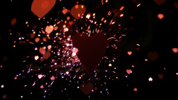 Sparks and confetti flying against heart Stock Video Footage