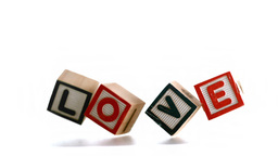 Building blocks spelling out love falling and boun Footage