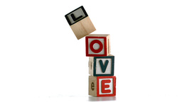 Stacked building blocks spelling out love falling  Footage