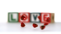 Heart beads falling and bouncing in slow motion Footage