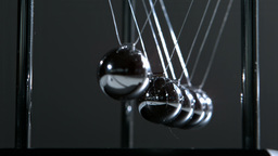 Newtons cradle in motion Stock Video Footage