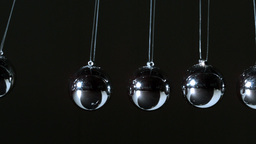 Newtons cradle close up Stock Video Footage