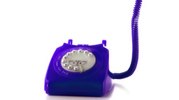 Receiver falling on purple dial phone Stock Video Footage