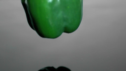 Green bell pepper falling into water Stock Video Footage