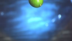 Lime falling into water Stock Video Footage