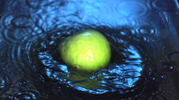 Green apple falling into water Footage