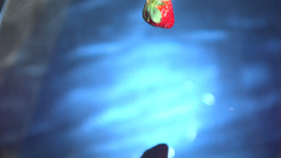 Strawberry falling into water Stock Video Footage