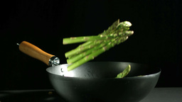 Asparagus falling into a wok Footage
