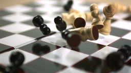 Chess pieces falling on board Footage