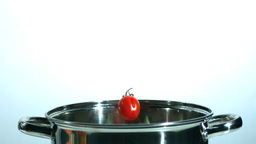 Cherry Tomatoes Falling In Pot stock footage