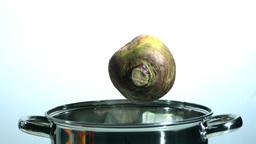 Turnip falling in a pot Footage