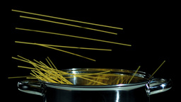 Spaghetti falling in pot Stock Video Footage