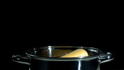 Parsnip falling in pot Stock Video Footage