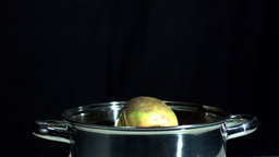 Turnip falling in pot on black background Stock Video Footage
