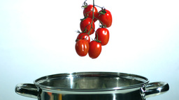 Vine tomatoes falling in saucepan Stock Video Footage