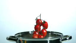 Vine tomatoes falling in saucepan Stock Video Footage