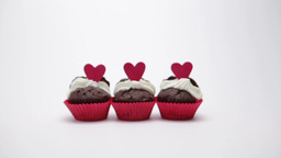 Three valentines cupcakes on white background Footage