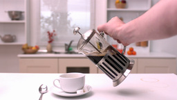 Coffee being poured in the kitchen Stock Video Footage
