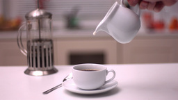 Milk pouring into coffee Stock Video Footage