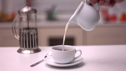 Milk pouring into coffee Footage