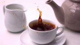 Cube of sugar falling in tea cup Footage