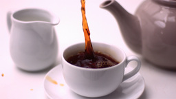Cube of sugar falling in tea cup Stock Video Footage