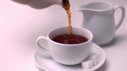 Tea pouring into tea cup Footage
