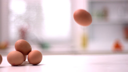 Egg smashing beside pile of eggs Stock Video Footage