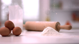 Flour sprinking on kitchen counter with baking tools Live Action