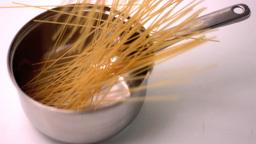Spaghetti falling in a pot Footage