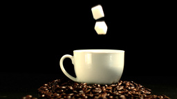 Sugar cube falling in coffee cup Stock Video Footage
