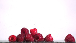 Water falling on raspberries Footage