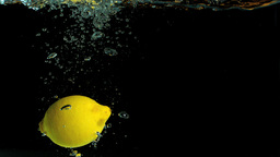 Lemon falling in water and floating Stock Video Footage