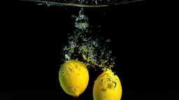 Lemons dropping in water Footage