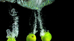 Three limes falling into water and floating Stock Video Footage