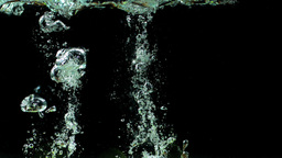 Three limes falling into water and floating Footage