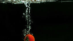 Tomato falling into the water Footage