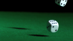 Dice falling and bouncing on green table Stock Video Footage