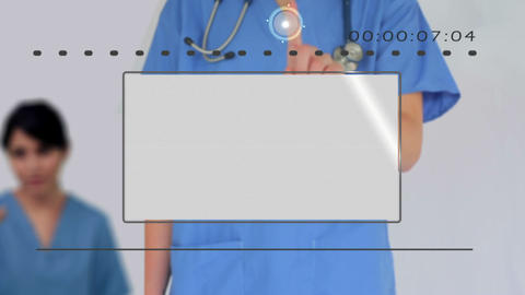 Nurse using digital touchscreen to look at various Animation