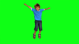 Boy jumping on green screen Stock Video Footage