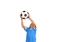Boy jumping and catching football Stock Video Footage