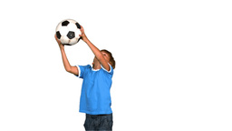 Boy jumping and catching football Footage