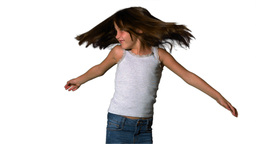 Little girl twirling on white background Footage