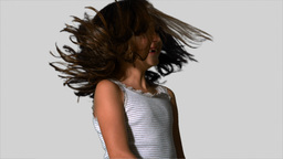 Little girl tossing her hair on white background Footage