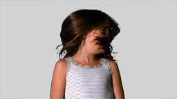Little girl shaking her hair on white background Footage