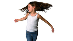 Little girl spinning around on white background Footage
