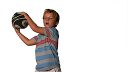 Little boy catching rugby ball on white background Stock Video Footage