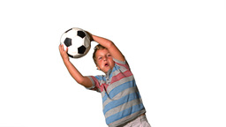 Boy catching football on white background Footage