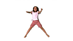 Girl jumping up and down on white background Stock Video Footage